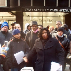 Rec. Sec. Benita Johnson stands with protesters outside of JPM Chase corporate offices