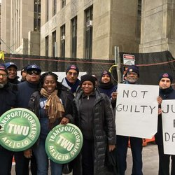 Local 100 outside Manhattan courthouse where a judge posthumously dismissed the case against CTA Goodwin