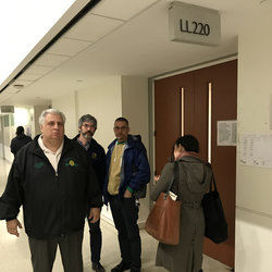 Local 100 President Tony Utano and elected officers leaving the Bronx courtroom Monday