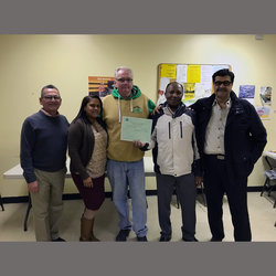 Local 100 Director of Organizing Frank McCann (center) stands with STA and School Bus Division Officers including Orlando Vasquez, Jemary Pabon, Jamille Aine, and Division Chair Gus Moghrabi.