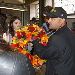 Danny's youngest daughter, Valerie, receives a wreath honoring her late father from Track Division Chairman Paul Navarro